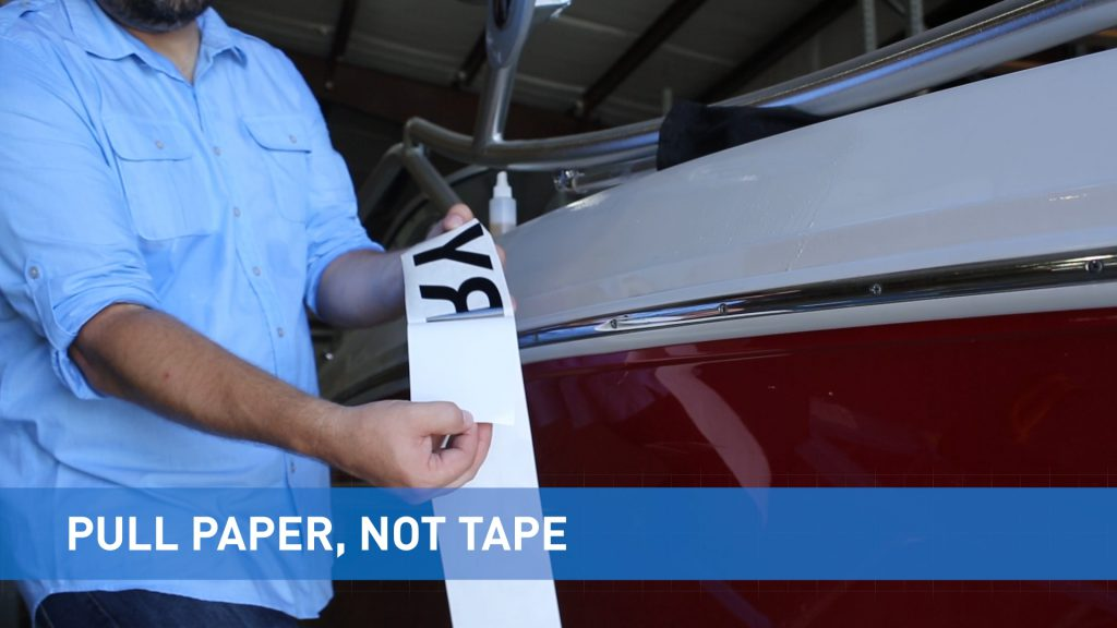 Peel back the paper, not the tape itself when removing registration numbers from backing.