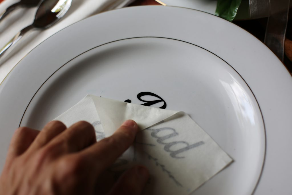 peeling vinyl tape off plate