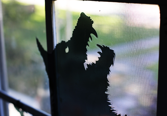 window decals of spooky monster